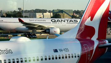 Qantas aircrafts are seen on the tarmac at Sydney Airport