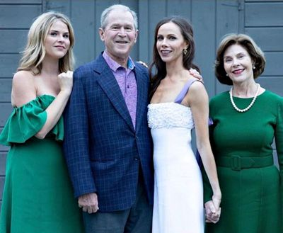 George W. Bush and his wife Laura Bush pose with their twin daughters, bride, Barbara Bush, and Jenna Bush Hager. Barbara wears a gown by Carolina Herrera.