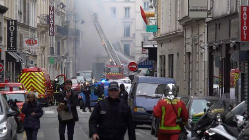 Smoke billowed out from the building, located near the famous Galeries Lafayette headquarters