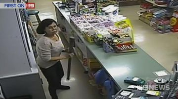 Female convenience store cashier fights back armed robber