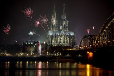 Fireworks burst next to the Cologne Cathedral during the New Year's Eve celebrations in Cologne, Germany.