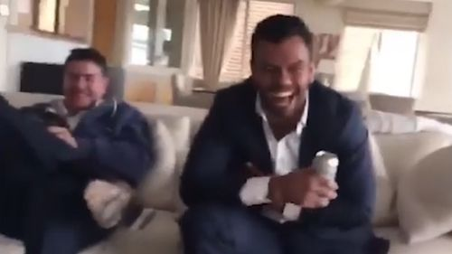 Kurtley Beale and another man are seen with grins on their faces in the video too.