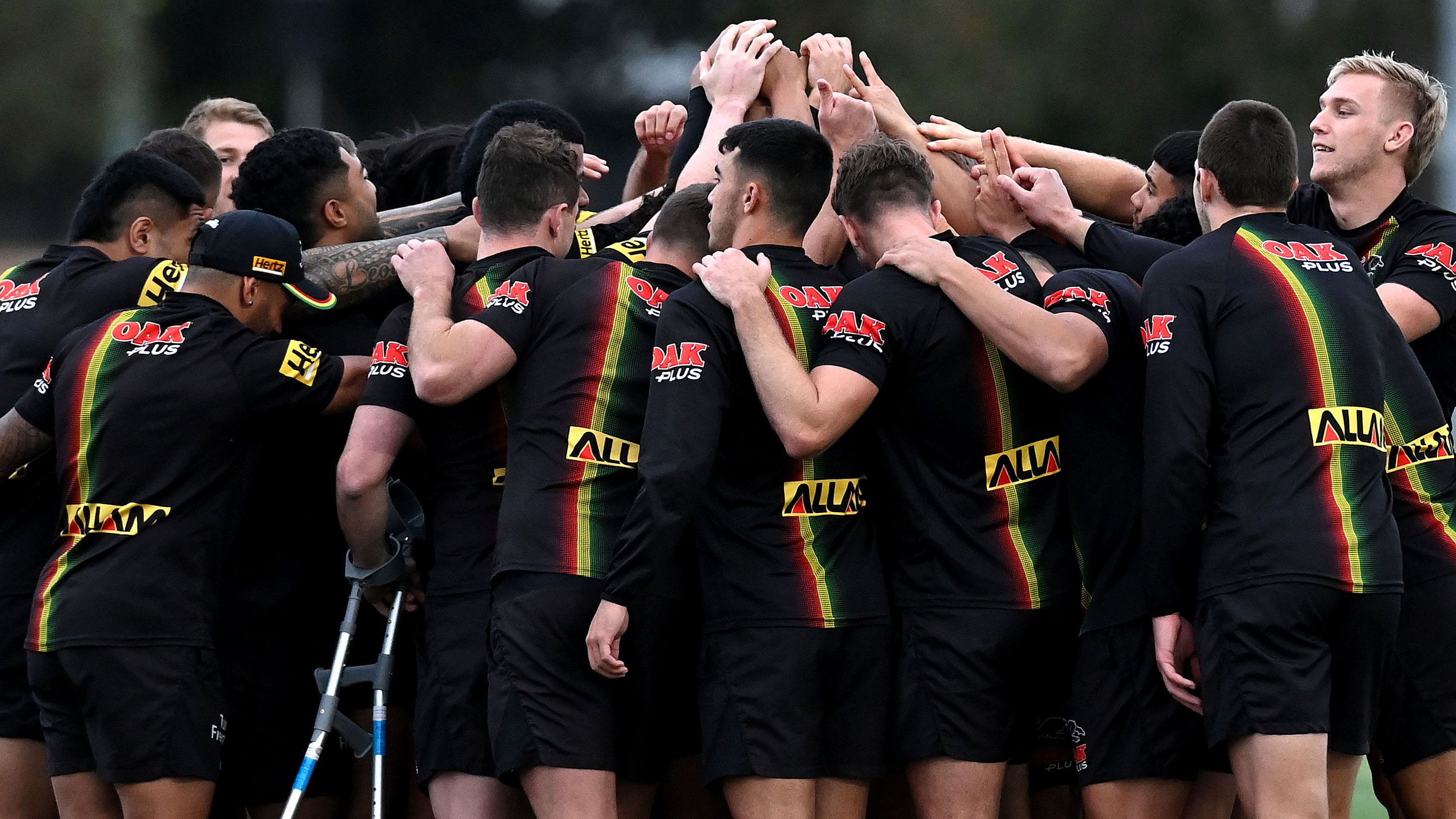 The players embrace during a Penrith Panthers training session at Sunshine Coast Stadium.