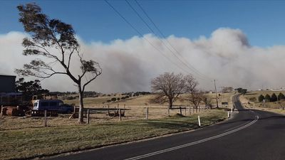 Out-of-control NSW bushfire fanned by wind