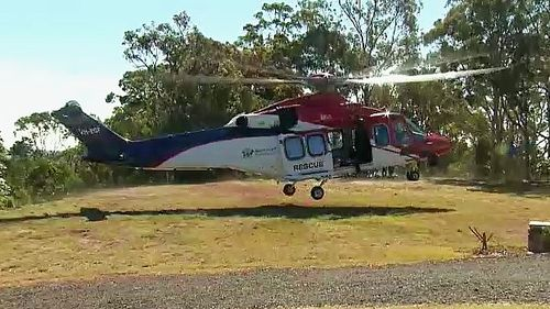 The Rescue 500 helicopter with a critical care paramedic are currently on scene, with the paramedic being winched down 70m to assess the woman.