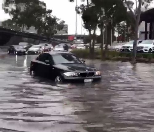 Cars have been submerged, leaving some motorists pushing their cars through the floodwaters.