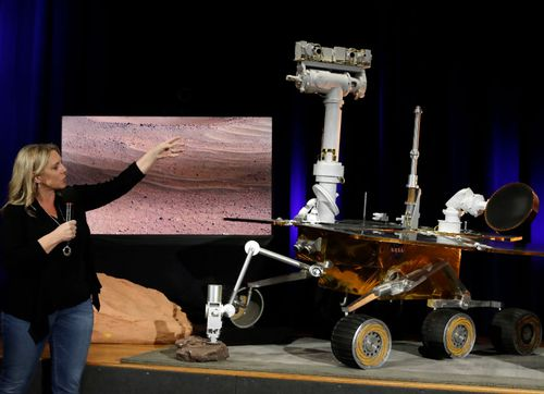 Project system engineer Jennifer Trosper, left, points to a replica of the Mars Exploration Rover Opportunity during a mission briefing at NASA's Jet Propulsion Laboratory.