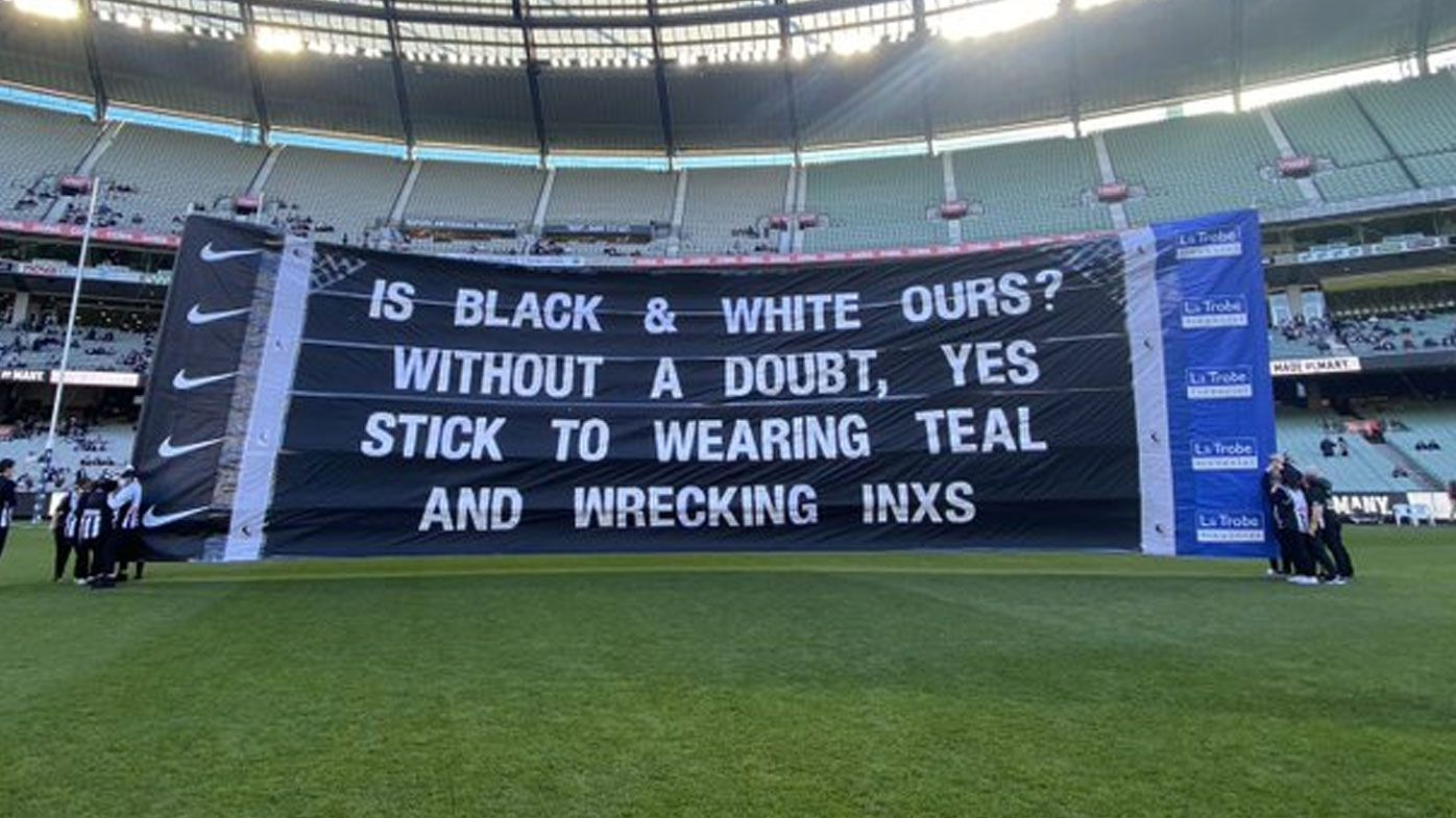 'Very cheeky': Collingwood's cheer squad takes jab at Port Adelaide over prison bar guernsey