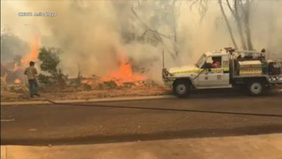Four homes feared lost in fierce bushfire