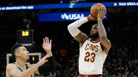 Cleveland Cavaliers forward LeBron James (23) shoots and scores over San Antonio Spurs guard Danny Green (14). The score allowed James to reach the 30,000 milestone for his career