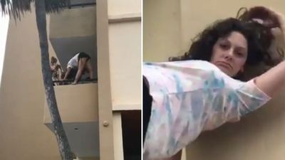 Woman 'on flakka' performs yoga while hanging off balcony's edge