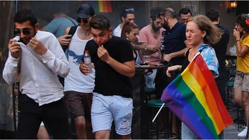 Turkish police dispersed LGBTQI activists on a street in central Istanbul, using tear gas.