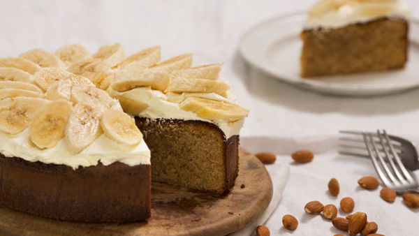 Flourless white chocolate and orange blossom almond cake with buttercream and banana