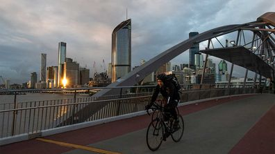 A cyclist travels along Southbank in Brisbane, Queensland.