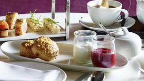 The Wilmot's lemon white chocolate scones with rhubarb, strawberry, gin jam and chantilly cream