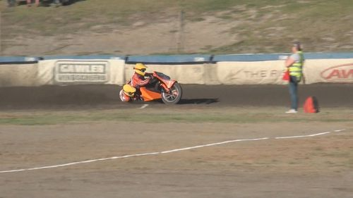 A rider and his passenger were badly injured in a crash during an Adelaide speedway race.