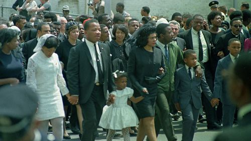 Coretta Scott King, center, widow of slain civil right Dr Martin Luther King Jr walk in the funeral procession with their children and family in Atlanta, Georgia, April 9, 1968. (AAP)