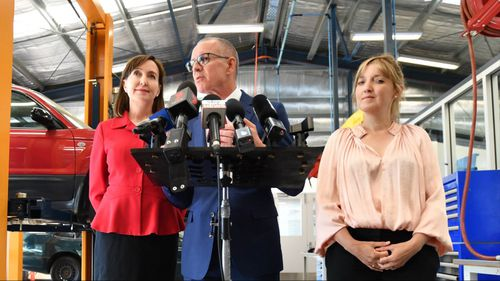 South Australia Premier Jay Weatherill, Labor candidate for Hartley Grace Portolesi (R), and SA Labor MP Kyam Maher at Charles Campbell College Trade School in Paradise. (AAP)