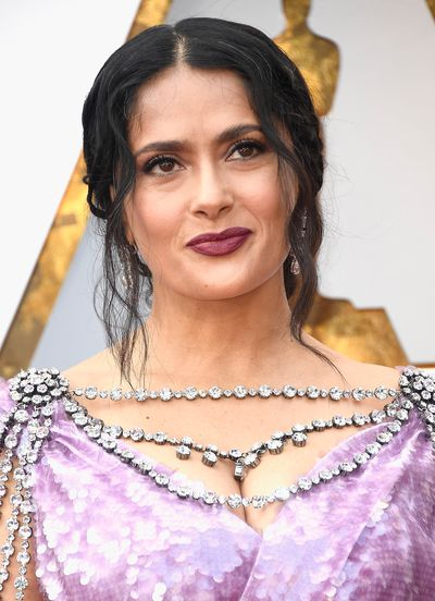 <p>Salma Hayek made waves for all the right reasons. The actress, 50, embraced her natural hair and let her grey streaks shine through in a low bun. Hayek paired her low-key hair with a deep rouge-noir lipstick  to contrast her lavender dress.</p>