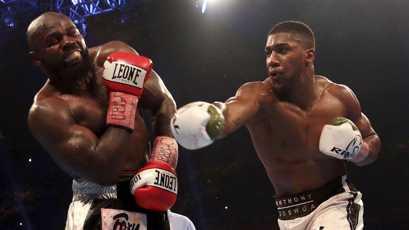 Anthony Joshua defeats Carlos Takam by TKO to retain WBA and IBF heavyweight title