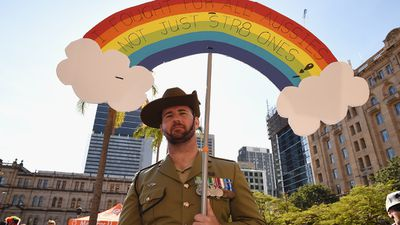 Beau Best poses for a photo during a Same-Sex Marriage march at Queen Gardens in Brisbane, yesterday. (AAP)