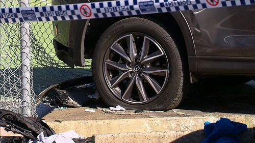 A woman was pinned against the fence after the car hit her. Image: 9News