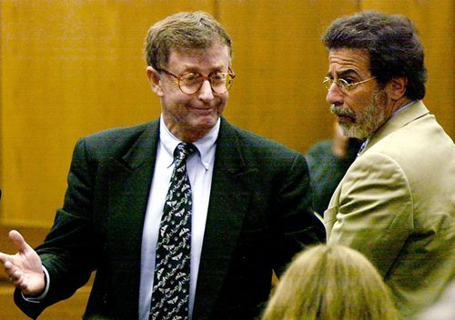 Michael Peterson, left, reacts after being found guilty of murdering his wife in October 2003. At right is his attorney David Rudolf. Novelist and onetime mayoral candidate Michael Peterson was found guilty of murdering his wife, whose body was found in a pool of blood at the bottom of a staircase in their home. His conviction was later overturned.