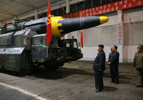 An undated photo released 15 May 2017 by North Korean Central News Agency (KCNA) showing North Korean leader Kim Jong Un (C) viewing a missile after North Korea