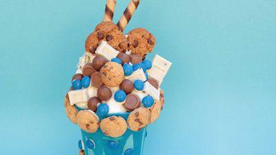 """<a href=""""http://kitchen.nine.com.au/2017/01/06/10/16/cookie-monster-milkshake-smash-cake"""" target=""""_top"""">Cookie Monster 'milkshake' smash cake</a>"""