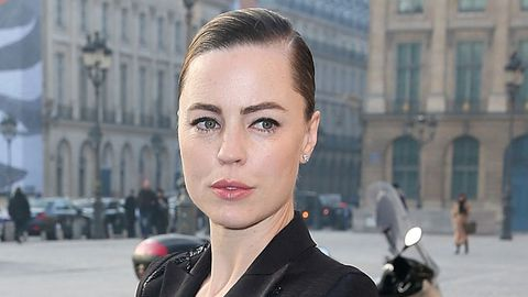 Melissa George's sister has spoken out in defense.