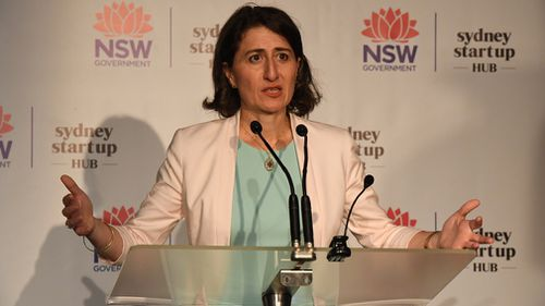 The threat puts the Berejiklian government in a tight spot after already facing pressures from within the community and among its own ranks over the controversy linked to the plan (AAP).