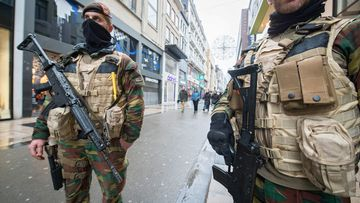 Armed soldiers on a Brussels street. (AAP)