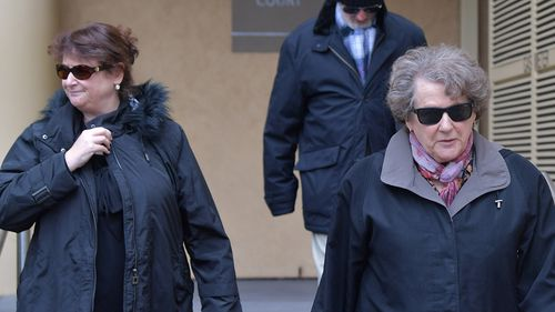 Michael Russell's wife Polly and her mother outside court. (AAP)