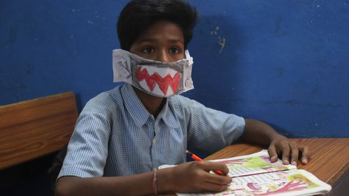 An Indian student in a handmade mask.