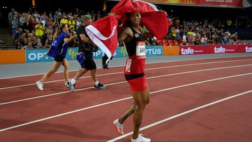 Michelle-Lee Ahye celebrates winning gold in the 100m. (AAP)