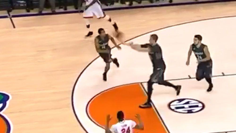 Basketballer nails amazing buzzer beater shot