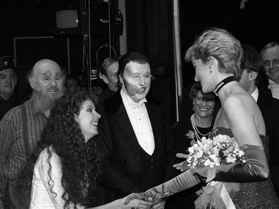 Phantom of the Opera star Michael Crawford (masked) and Sarah Brightman meet Diana, Princess of Wales after a charity performance of the hit musical at her Majesty's Theatre in London.
