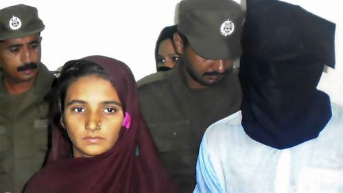Asia Bibi and her boyfriend, Shahid Lashari, are presented to journalists, at police station in Muzaffargarh in Pakistan on October 30. (AAP)