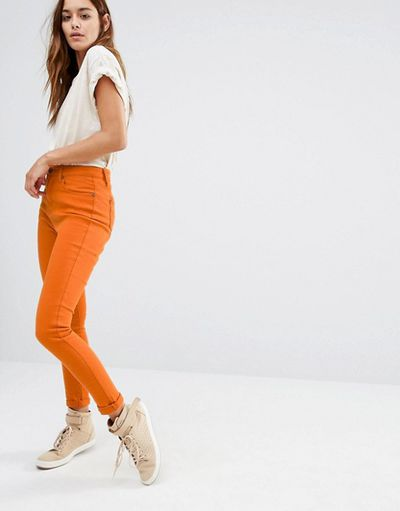 "High-rise skinny jeans, $76, Liquor and Poker at <a href=""http://www.asos.com/au/liquor-poker/liquor-poker-high-rise-ankle-skinny-jeans/prd/6832765?iid=6832765&clr=Rust&SearchQuery=orange&pgesize=36&pge=1&totalstyles=1270&gridsize=3&gridrow=6&gridcolumn=2"" target=""_blank"">ASOS</a><br />"
