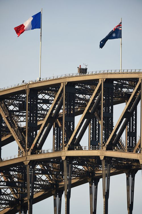 The French flag flies beside the Australian on the Sydney Harbour Bridge as a sign of solidarity after the Nice attack. (AAP)