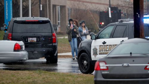 Students leave Great Mills High School following a shooting at the school in Maryland. (AAP)