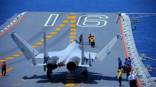 A fighter jet takes off from a Chinese aircraft carrier.