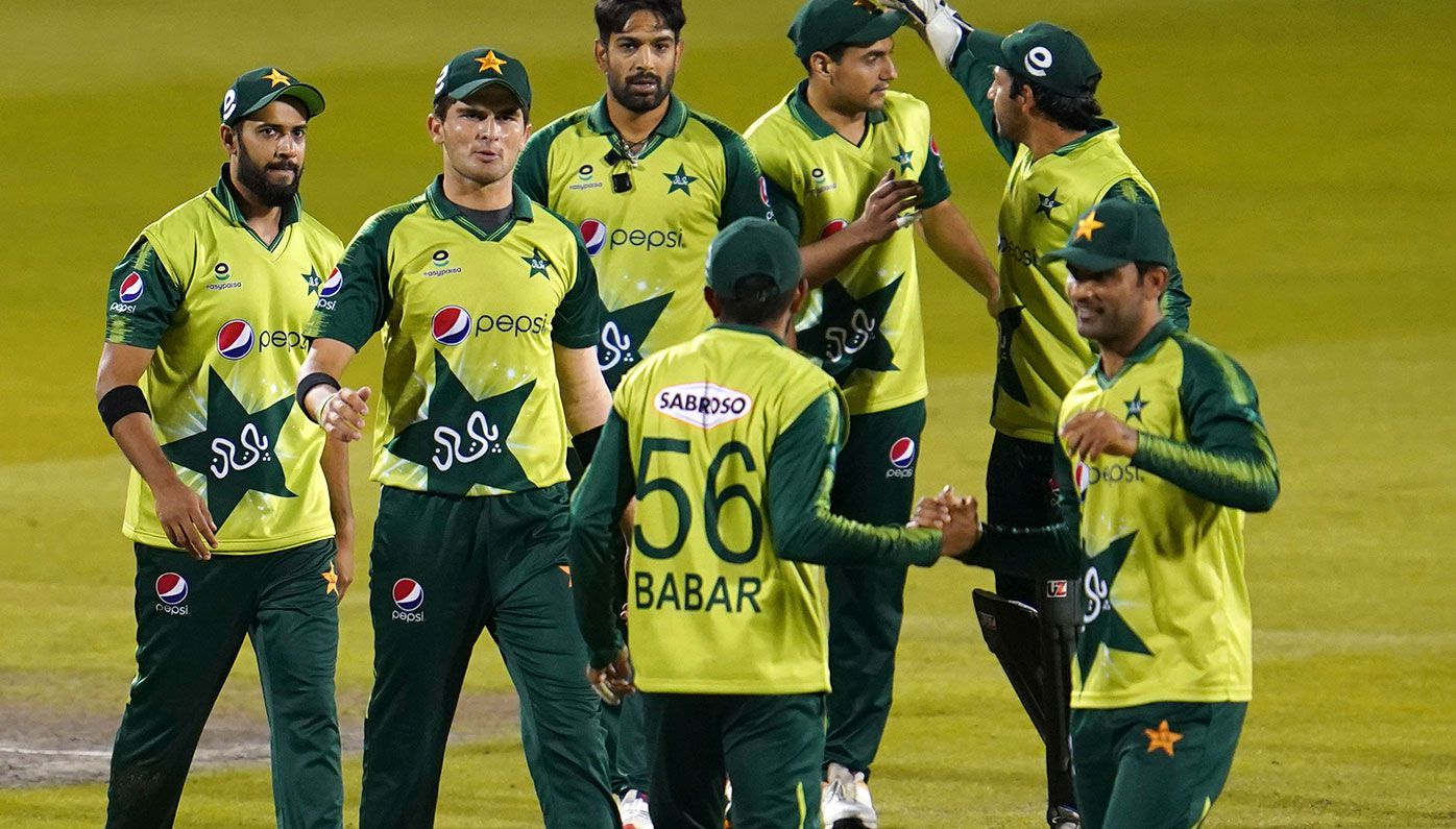 In this file photo, Pakistan players celebrate their win in the third Twenty20 cricket match against England at Old Trafford in Manchester, England. Six members of the Pakistan cricket squad in New Zealand have tested positive to COVID-19.