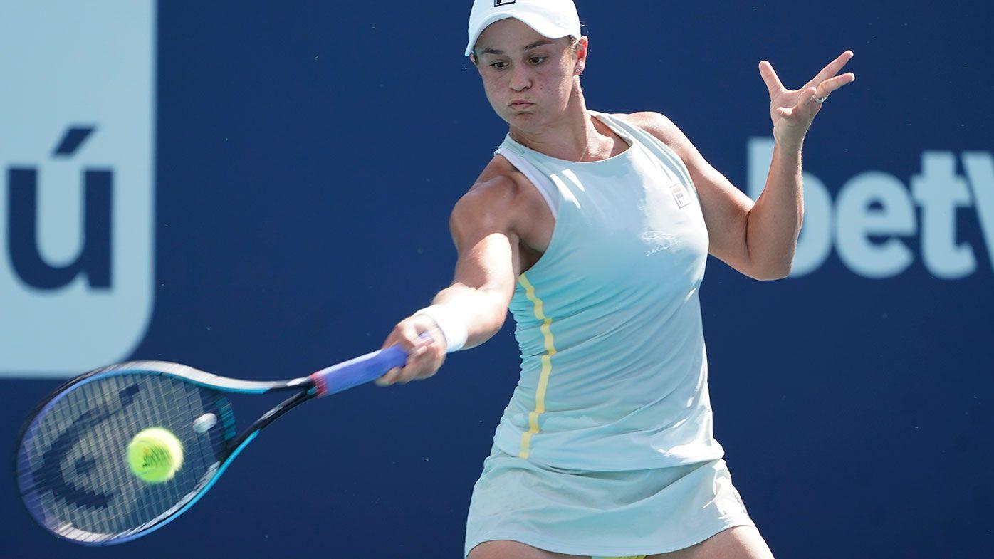 Ashleigh Barty, of Australia, returns to Kristina Kucova, of Slovania, during the Miami Open tennis tournament.