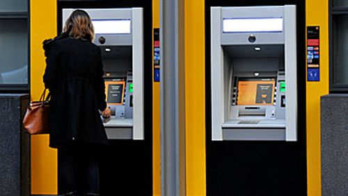Woman at Commonwealth Bank ATM (AAP)