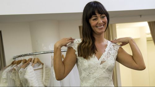 Participant Michelle tries on her wedding dress. (Nine Network)