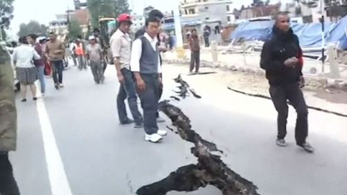 A crack along the Koteshwor-Suryabinayak Highway caused by the earthquake in the Bhaktapur area near Kathmandu.