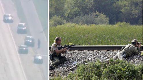 Massive manhunt underway after policeman shot dead in Illinois