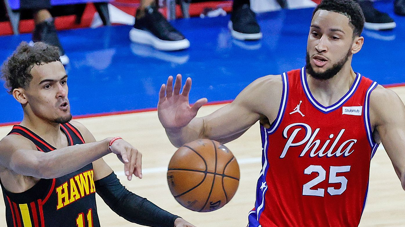 Trae Young #11 of the Atlanta Hawks passes past Ben Simmons #25 of the Philadelphia 76ers