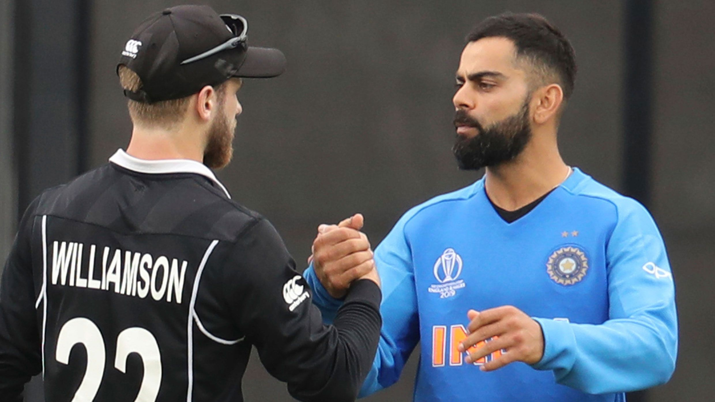 Kane Williamson is congratulated by Virat Kohli.